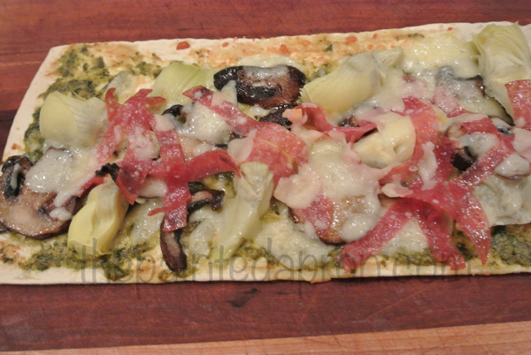 flatbread with salami, pesto and artichokes thepaintedapron.com