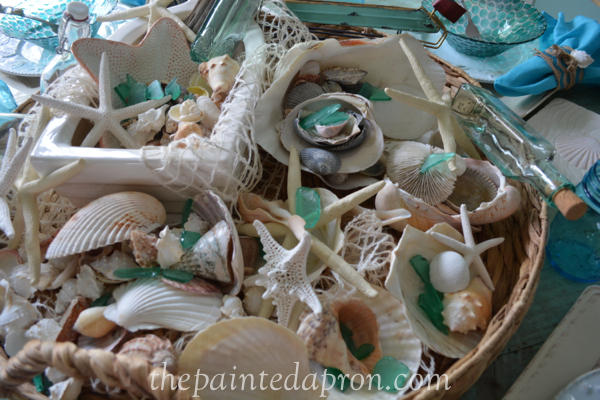 shell filled basket thepaintedapron.com