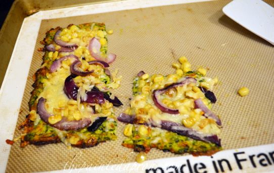 zucchini crust corn and onion pizza thepaintedapron.com