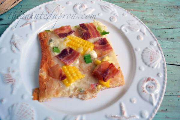 queso corn and bacon pizza