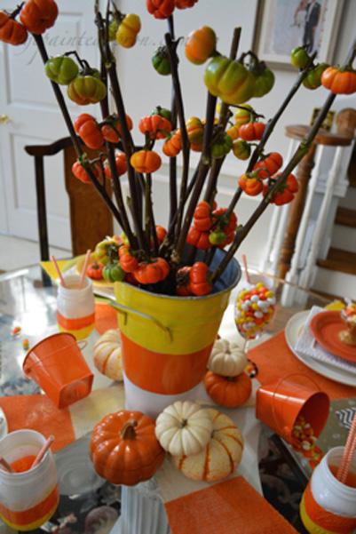 candy corn pumpkin centerpiece thepaintedapron.com