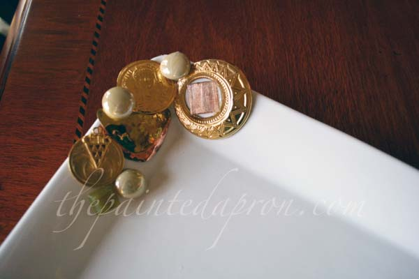 gold jewerlry collage tray